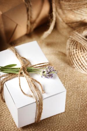 Handmade gift box with lavender sprig on burlap photo