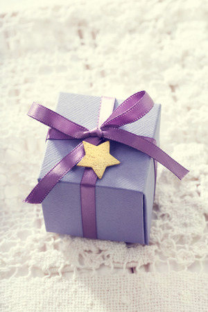 Handmade present boxes with purple ribbons and star shaped tags Stock fotó - 27917913