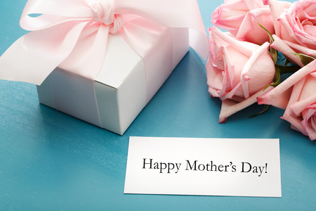 Mothers day message card with gift box and pink roses