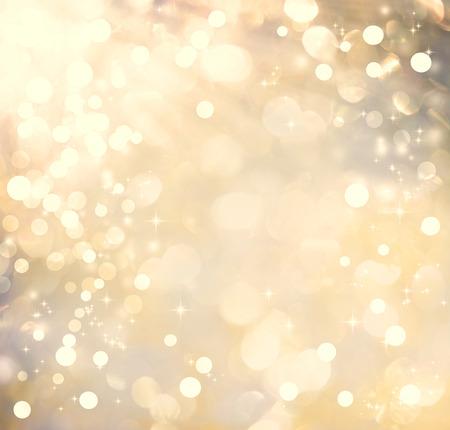 黄金色の光沢のある光ときらめきの背景