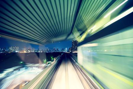Tokyo automated guide-way train  Yurikamome  at night Stock Photo