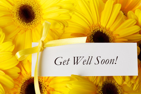 Get Well Soon message card with yellow gerberas Stock Photo