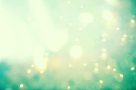 青緑色の抽象的な光沢のある光のグラデーション背景 写真素材