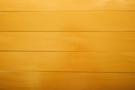 Blank yellow colored wooden boards aligned horizontally photo