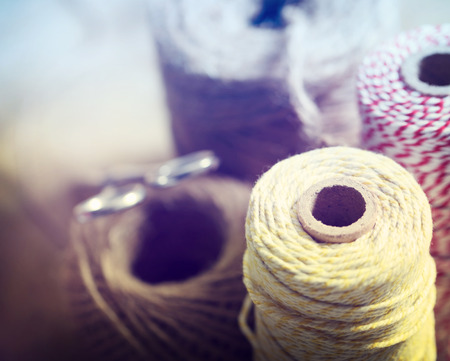 handcrafted: Spools of different color string with scissors