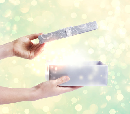 A magical glowing present box being opened Stock Photo - 30101783