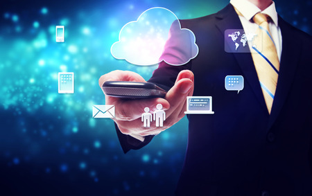 holding smart phone: Smart phone cloud connectivity service theme with business man