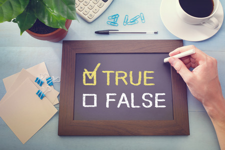 True or False checkboxes with True checked, sketched on a little black chalkboard Stock Photo