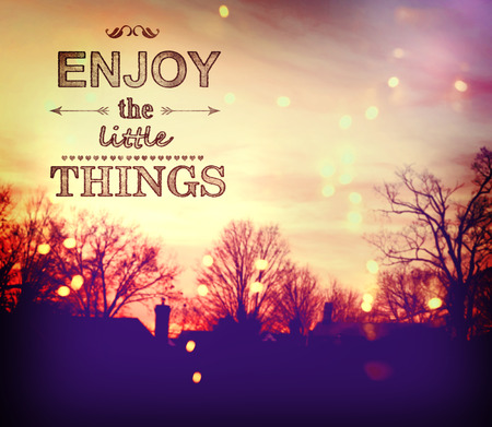 Enjoy the Little Things text on twilight background