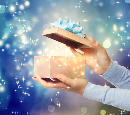 A magical glowing present box being opened  photo