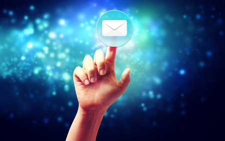 Hand pressing a envelope icon over technology blue background