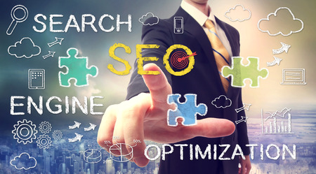 seo: Businessman pointing at SEO (search engine optimization)