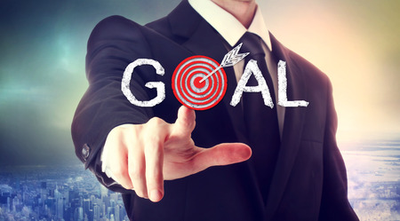 Business man pointing to the target, reaching the goal photo