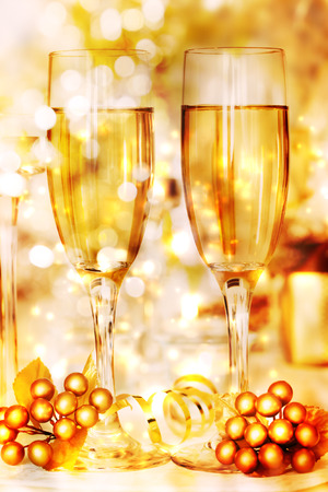 atmosphere: Glasses of golden white wine in celebratory atmosphere Stock Photo