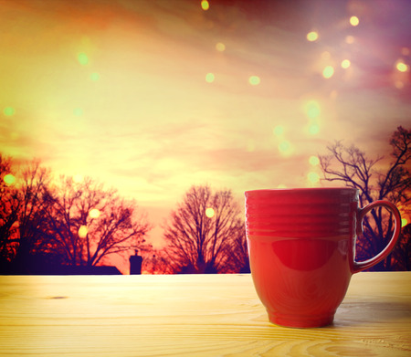 peace concept: Red Coffee Mug Overlooking a Twilight Scene  Stock Photo