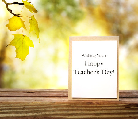 happy day: Happy teachers day message with yellow autumn leaves background