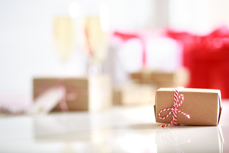 gift parcel: Handmade present boxes on a white table