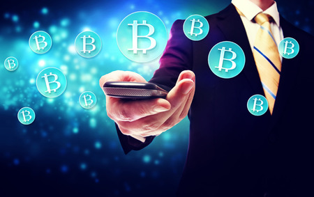 Bitcoin currency with a smart phone and businessman