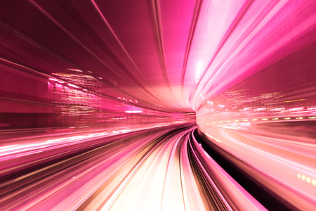 red pink: Automated guide-way train at night in Japan Stock Photo