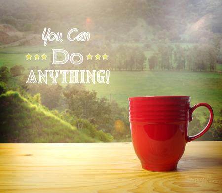 cotizacion: Usted puede hacer cualquier cosa texto sobre fondo paisaje rural con la taza de café