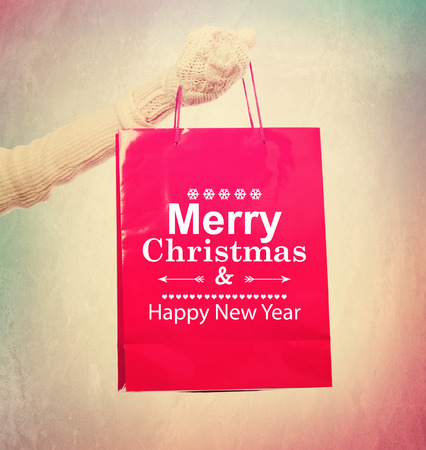 Merry Christmas and Happy New Year red shopping bag photo
