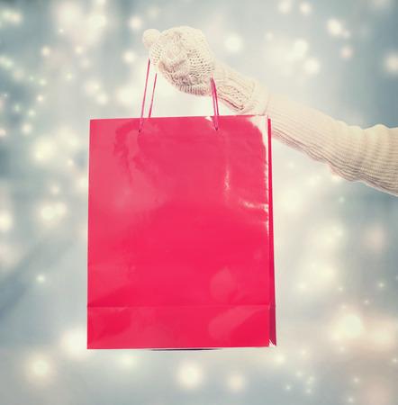 Girl holding big red Christmas shopping bag
