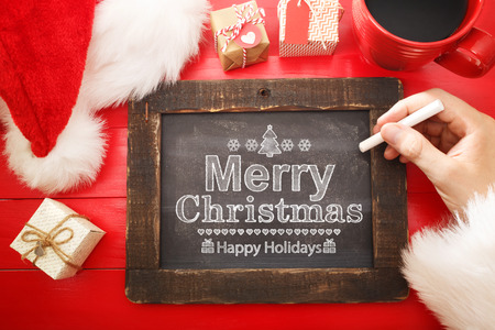small table: Merry Christmas text with a chalkboard on red table
