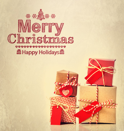 Merry Christmas message with handmade gift boxes photo