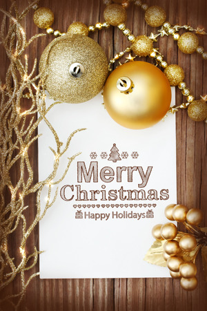 Christmas ornaments on wooden board with Merry Christmas message photo