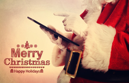 tablet: Merry Christmas message with Santa Claus with tablet