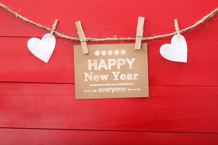 Happy New Year everyone text and felt hearts with clothespins photo