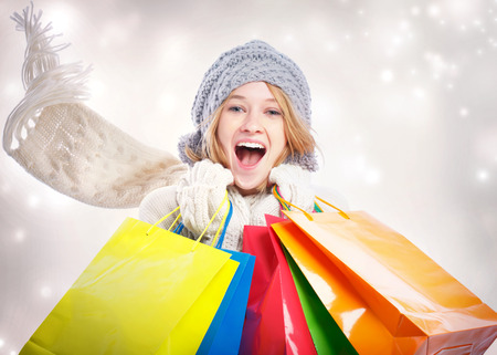 christmas shopping bag: Happy Young Woman with Colorful Shopping Bag