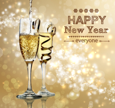 Happy New Year text with champagne glasses photo