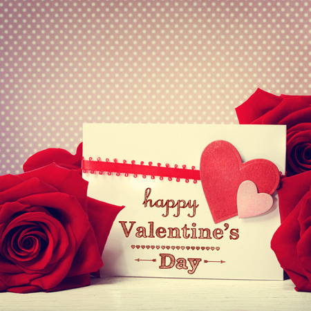 Valentines day message with vivid red roses photo