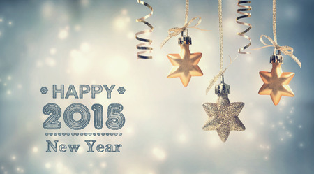 fonts year: Happy New Year 2015 text with hanging star ornaments Stock Photo