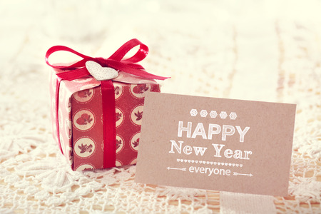 Happy New Year message card with cute giftbox Stock Photo
