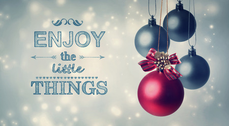 Enjoy the little things holiday spirit with Christmas baubles Stock Photo