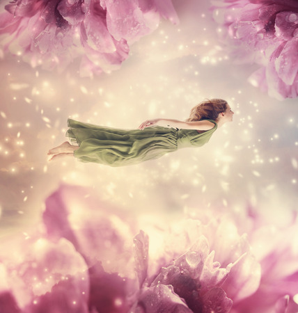flying woman: Beautiful young woman with giant peony flowers Stock Photo