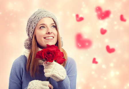 womans: Happy young woman holding red roses with hearts Stock Photo