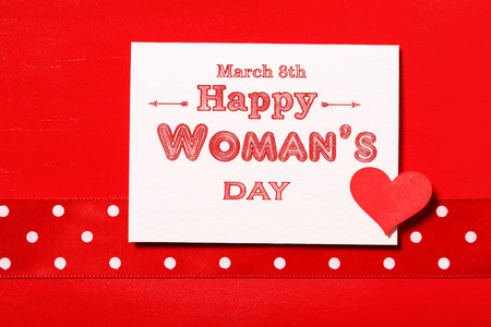 Happy Womans Day message with red heart and polka dots ribbon photo