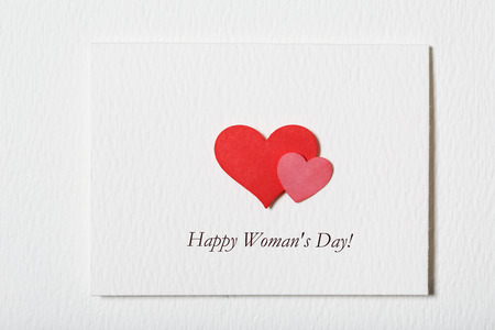 womans: Happy Womans Day white message card with hand made hearts