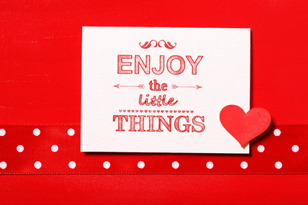 Enjoy the little things text with small red heart