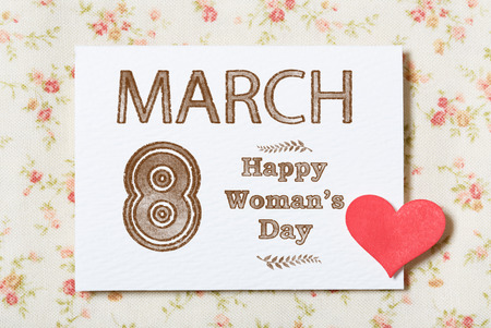 womans: March eighth, Happy Womans Day card with floral fabric background