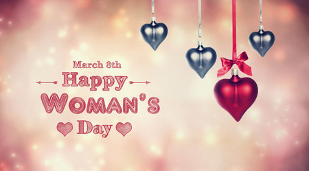 womans: Happy Womans Day message with hanging heart shaped ornaments