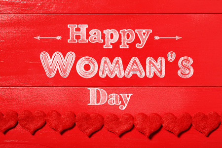 womans: Happy Womans Day message on red wood background with red hearts boarder