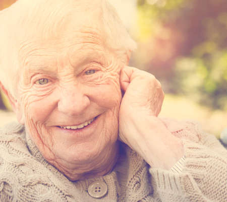 80 plus adult: Senior woman with a big happy smile outside