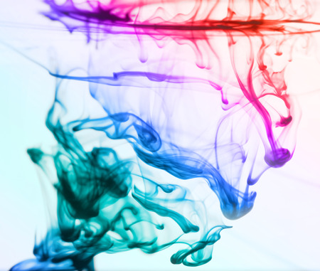 ink stain: Colorful ink drops swirling in the water