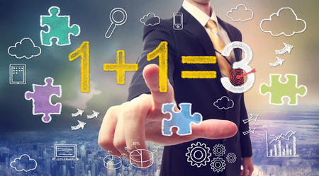 Businessman pointing at synergy concept 1+1=3 with cartoon photo