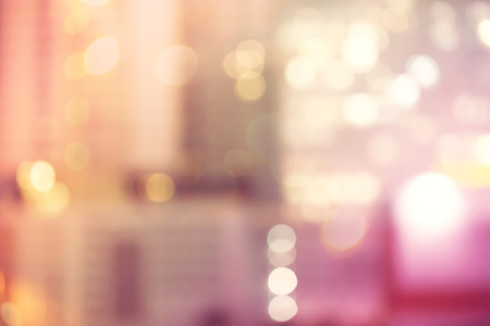 Blurred pink and orange urban building background scene Standard-Bild