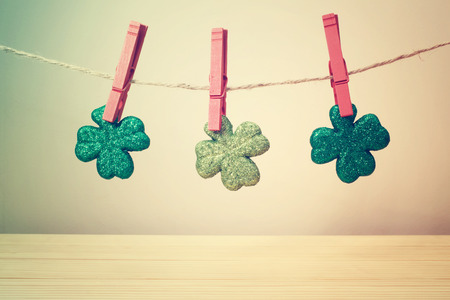 red clover: Saint Patricks Day clover leaves hanging with red clothespins